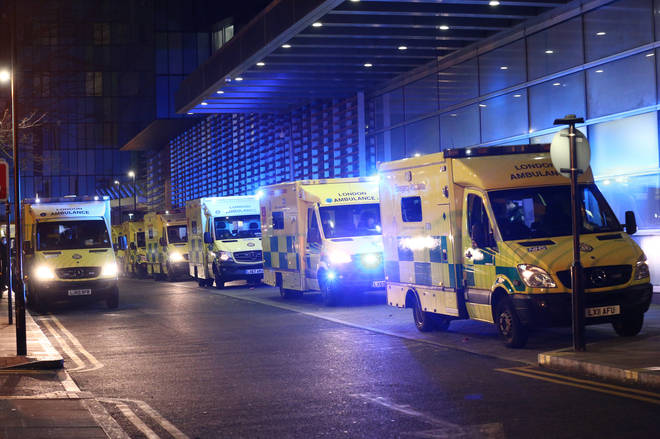 Ambulances queued outside the Royal London Hospital, in London, as hospitals face being overwhelmed.