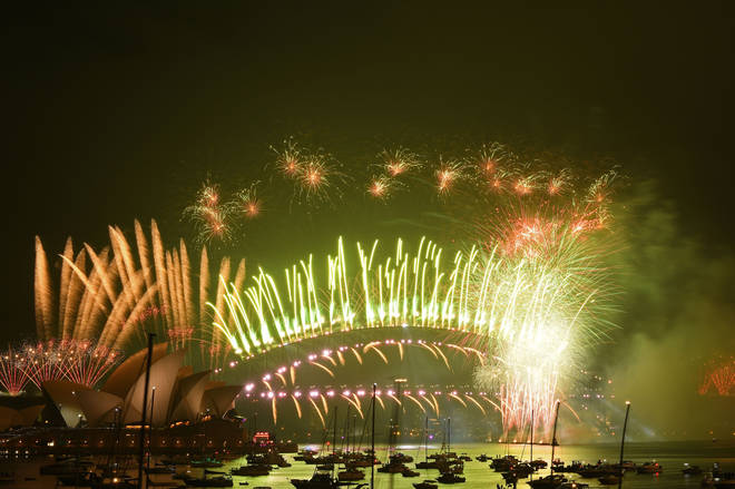 New Year's Eve fireworks erupt over Sydney's iconic Harbour Bridge and Opera House