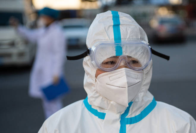 A medical worker is seen in the Shunyi District of Beijing