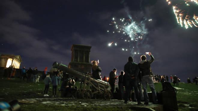 Some lit fireworks on Calton Hill, Edinburgh, despite Hogmanay celebrations being cancelled