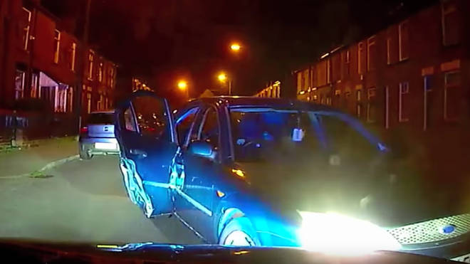 Burlgars rammed a chasing police car during a chase in Bury