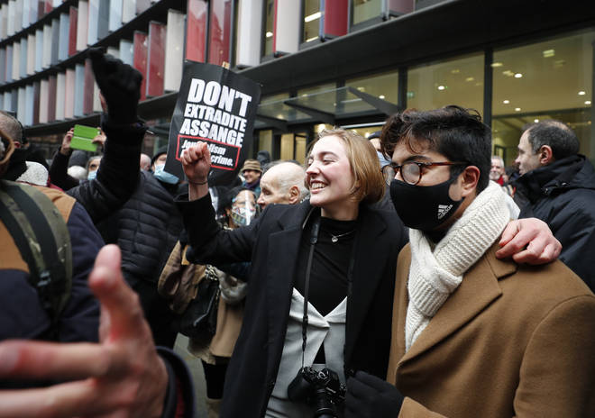Julian Assange supporters celebrate the judge's extradition ruling