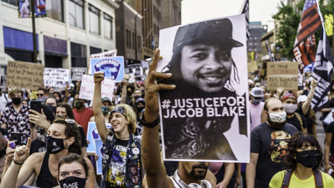 Protesters march near the Minneapolis 1st Police precinct during a demonstration against police brutality and racismin Minneapolis