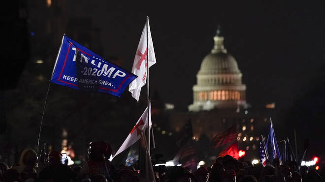 People attend a rally at Freedom Plaza in support of President Donald Trump
