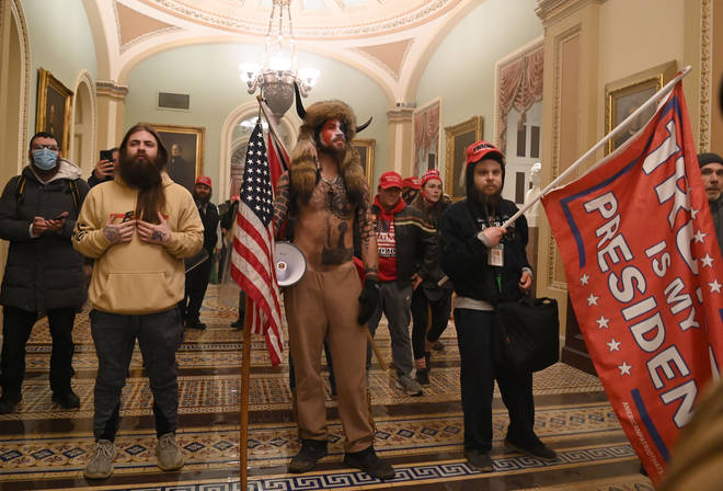 Supporters of US President Donald Trump enter the US Capitol
