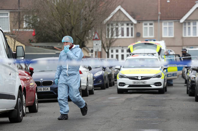 A 28-year-old woman has been arrested after two men died at a house in east London, police said