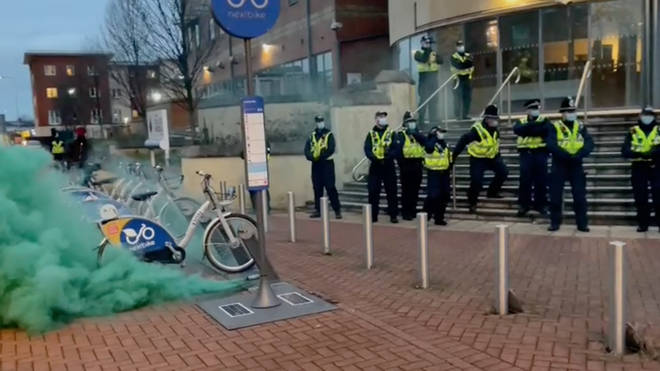 Smoke grenades were set off during protests outside Cardiff Bay Police Station