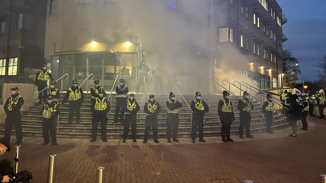A line of police officers formed a line outside Cardiff Bay Police Station