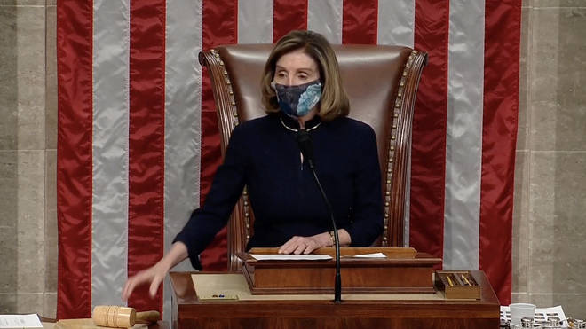 Nancy Pelosi announces that the vote has carried to impeach Donald Trump