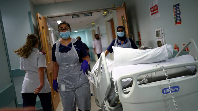 Medical staff transfer a patient through a corridor at The Royal Blackburn Teaching Hospital in East Lancashire