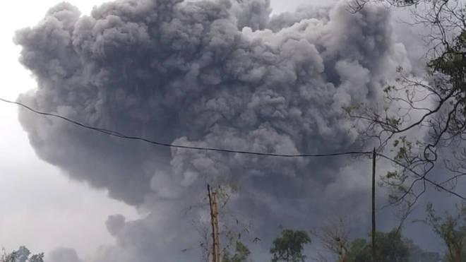 Mount Semeru spews volcanic material during an eruption in Lumajang