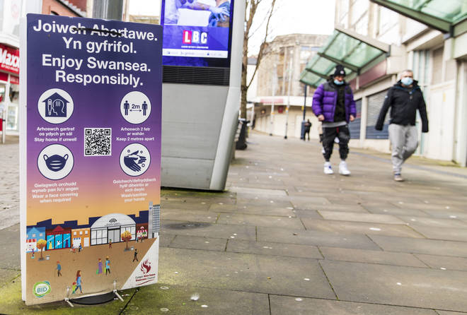 A Covid-19 safety measure poster seen in Swansea, Wales