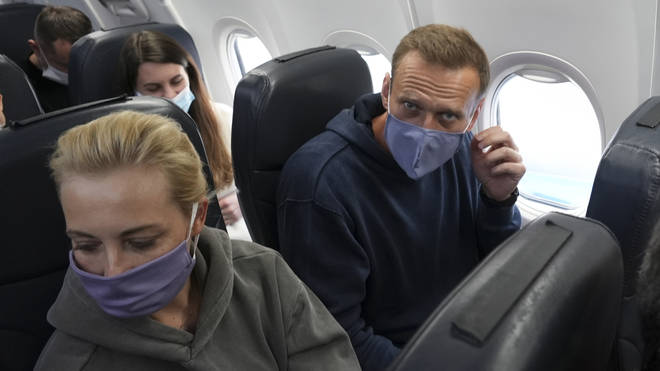 Leading Kremlin critic Alexei Navalny flew home to Russia on Sunday after recovering in Germany from his poisoning in August with a nerve agent