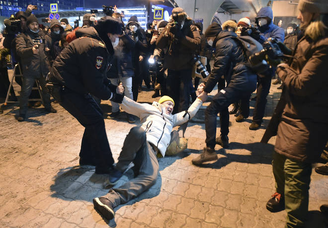 Supporters of Alexei Navalny were detained by police at a Moscow airport on Sunday
