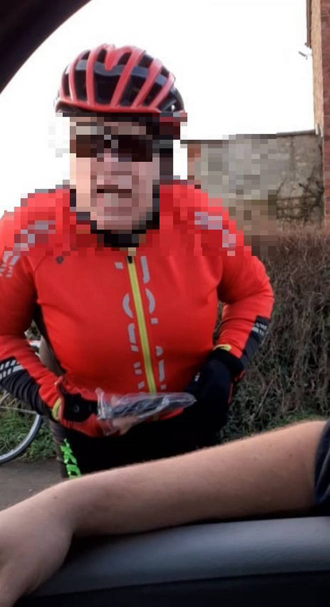 The cyclist can be heard yelling at the driver