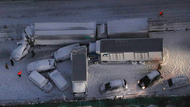 Damaged cars covered with snow after a multi-vehicle accident