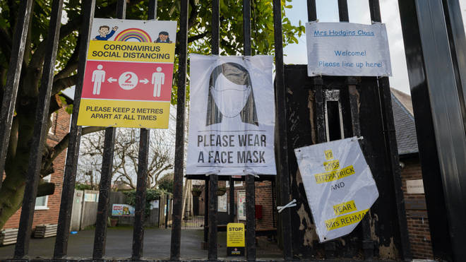 Posters informing on social distancing and face coverings outside Beatrix Potter Primary School in Wandsworth