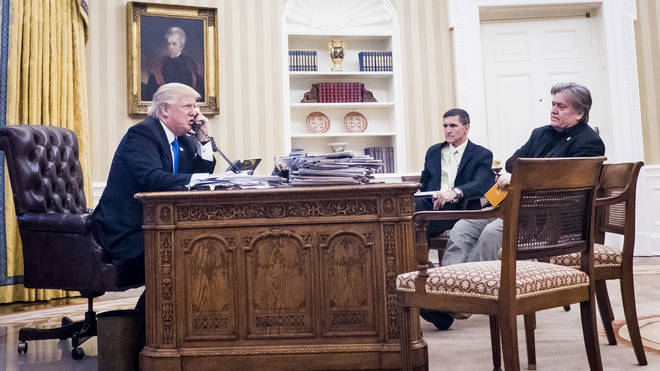 Steve Bannon, sit nearby as President Donald Trump speaks on the phone with Prime Minister of Australia, Malcolm Turnbull in the Oval Office on January 28, 2017