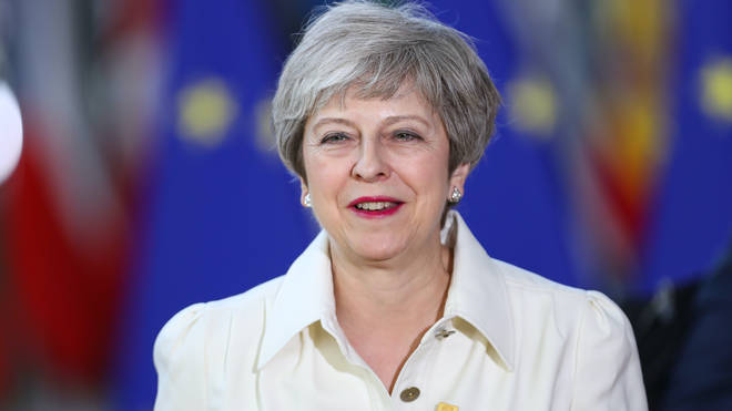 Theresa May said the UK was well placed to play a decisive role in shaping a more cooperative world