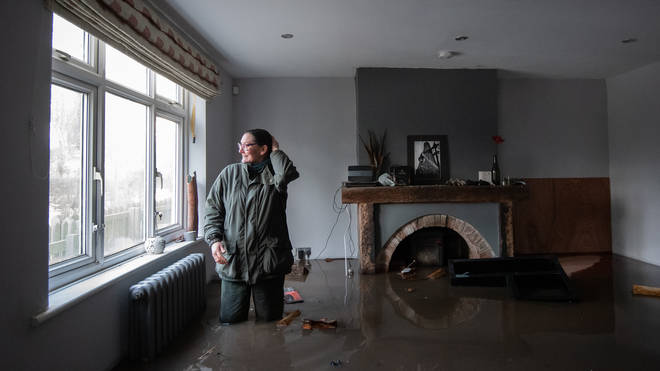 Gabrielle Burns-Smith looks out from her flooded home on the outskirts of Lymm in Cheshire