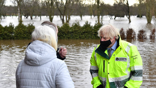 Boris Johnson speaks to residents who have been evacuated in Withington, Manchester