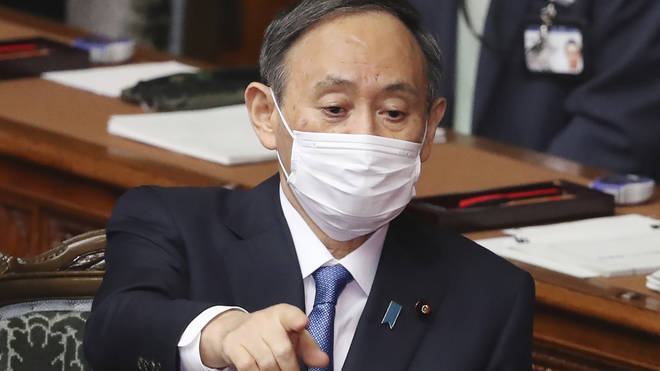 """Prime Minister Yoshihide Suga said the games would show """"proof of human victory"""" against the virus"""