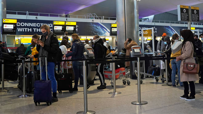 File photo of customers queuing at the check-in desk in Heathrow's Terminal 2 departures hall