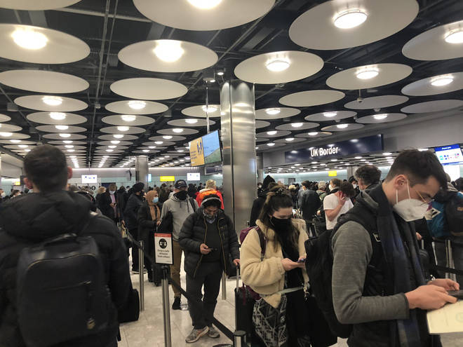 Passengers at Heathrow have complained of long waits at border control with little social distancting.