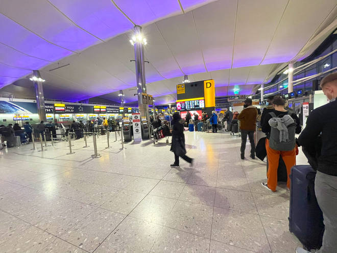 Images posted on social media showed little social distancing despite a largely empty airport.