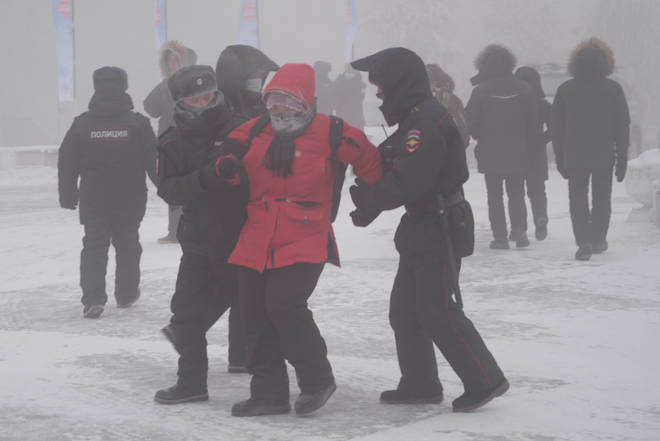 Police officers detain a participant in an unauthorized rally in support of Russian opposition activist Alexei Navalny near Ordzhonikidze Square in Yakutsk.