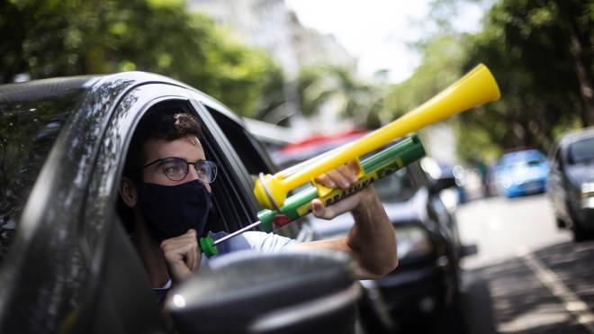 Virus Outbreak Brazil Protest