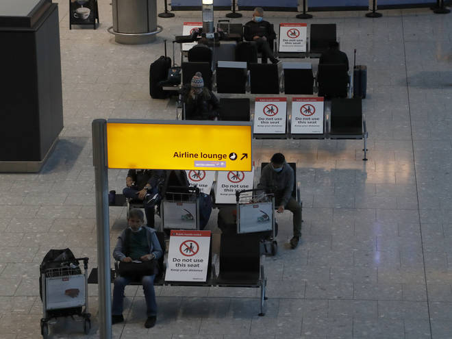Travellers wait for their Covid-19 test results at Heathrow Airport
