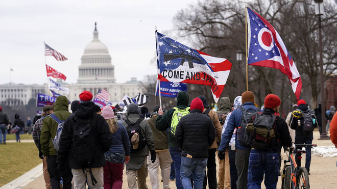 Supporters of former president Donald Trump marching towards the Capitol on January 6
