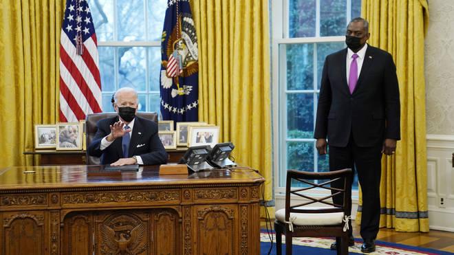 President Joe Biden meets with secretary of defence Lloyd Austin