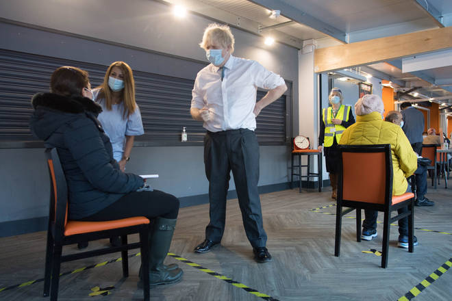 British Prime Minister Boris Johnson meets staff and patients at Barnet FC's ground, The Hive, which is being used as a coronavirus vaccination centre