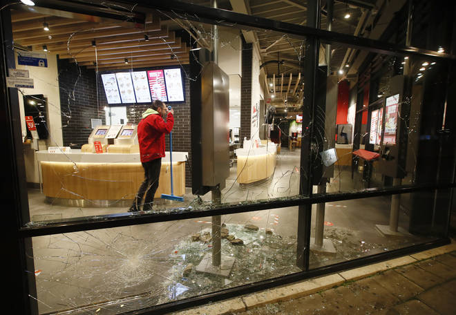 Smashed windows in a fast-food restaurant in Rotterdam that was damaged in protests