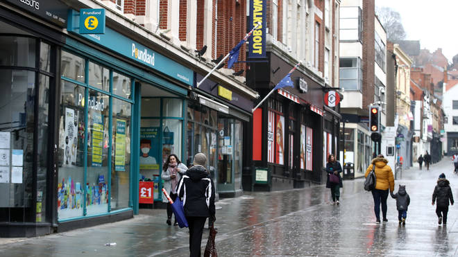 Shoppers walking past closed shops and Poundland in Lincoln city centre
