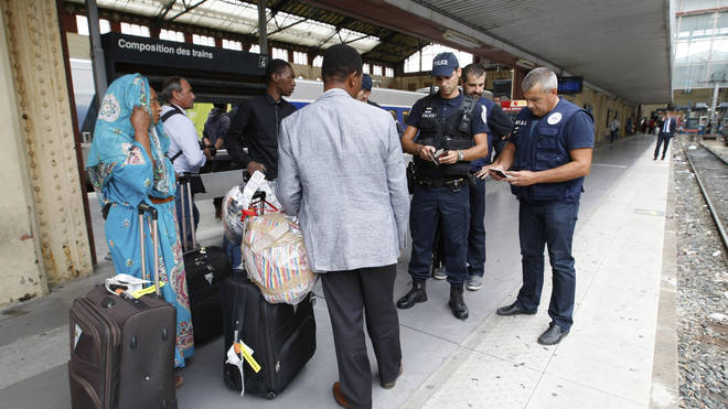 French police check identity documents at Saint-Charles station in Marseille