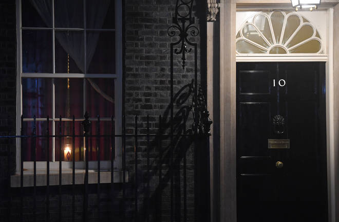 A candle in a window at 10 Downing Street in remembrance of victims of The Holocaust