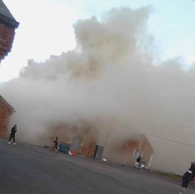 Plumes of smoke have been seen billowing out from a building