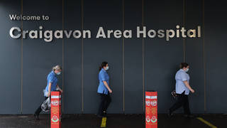 File photo: Healthcare workers walking towards the main entrance of Craigavon Area Hospital