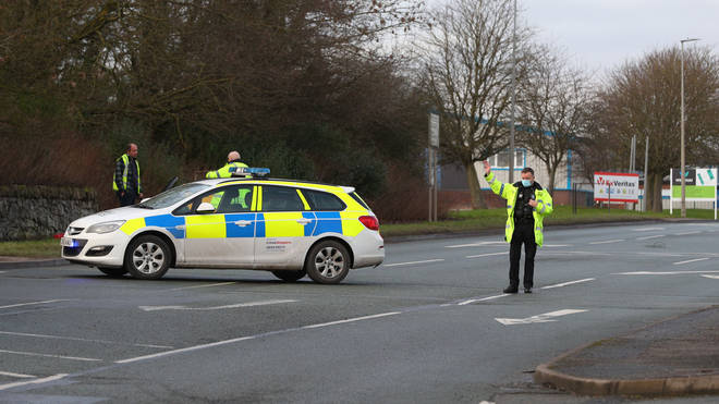 Police cordons on Abbey Road outside the Wrexham Industrial Estate near the Wockhardt site