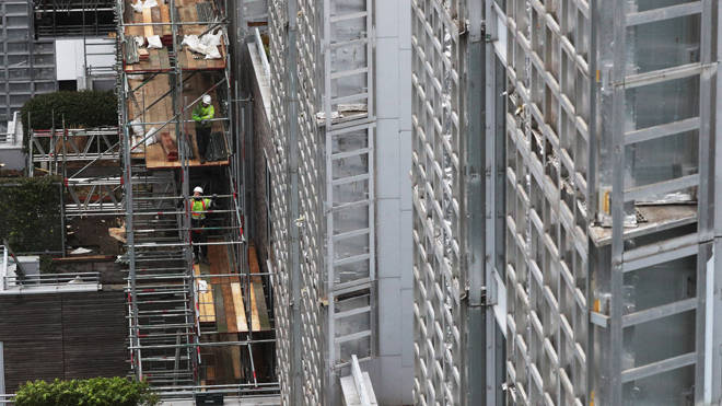 Contractors undertake works at a residential property in Paddington, London, as part of a project to remove and replace non-compliant cladding