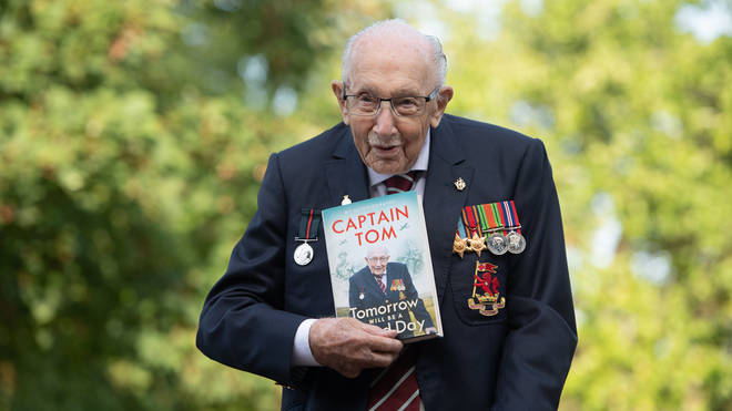 Capt Sir Tom holds his autobiography