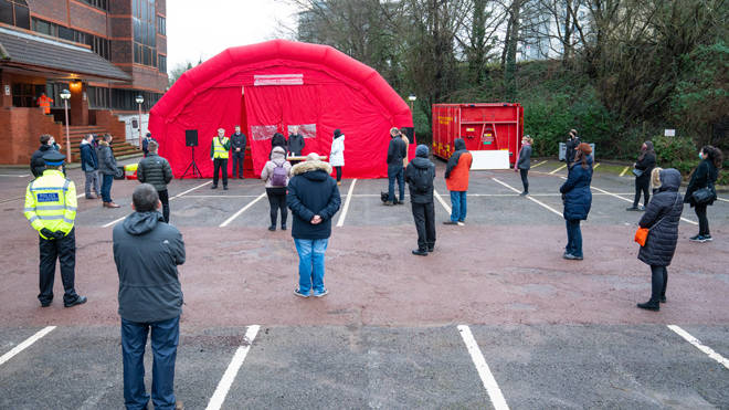 Volunteers are briefed at Woking Fire Station before carrying out door-to-door coronavirus testing