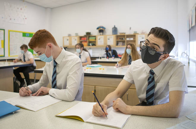 S4 pupils at St Columba's High School in Gourock, Inverclyde, wear protective face masks during their chemistry lesson