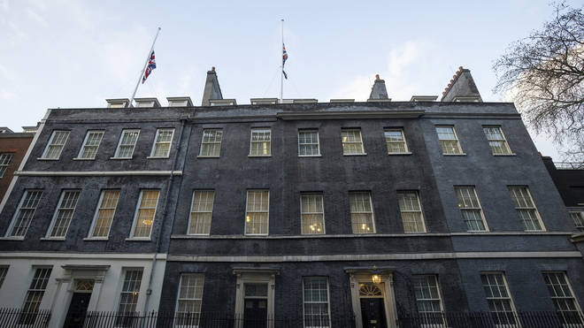 The flags in Downing Street were lowered to half-mast to mark Cpt Tom's passing