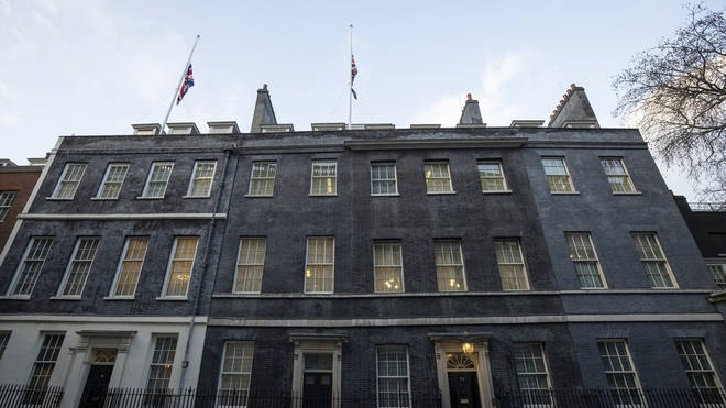 Flags are flown at half-mast outside Downing Street following the death of Sir Tom