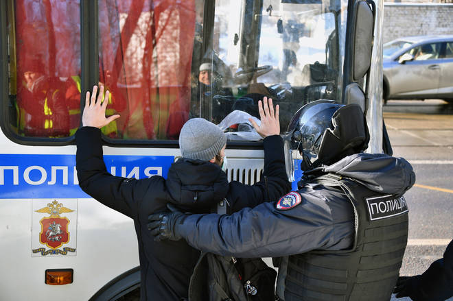Protesters were confronted by heavily-armoured police officers in Moscow
