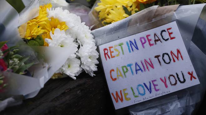 Flowers left outside Captain Sir Tom's family home